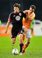 Dejan Jakovic of United fights through the Dynamo defense. Houston ousted D.C. United from the MLS Cup Final with a 1-1 tie at the RFK Stadium in Washington, D.C. on Sunday, November 19, 2012.  Alan P. Santos/DC Sports Box