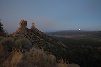 Chimney Rock (right) and Companion Rock (left) in the evening, at Chimney Rock National Monument, in Chimney Rock State Park, in San Juan National Forest, South West Colorado, USA. The ridge was an ancestral Puebloan site occupied 925-1125 AD by around 2000 Indians. Chimney Rock was made a National Monument in 2012 and is listed on the US National Register of Historic Places and the Colorado State Register of Historic Properties. Picture by Manuel Cohen