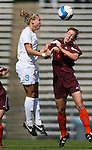 North Carolina's Whitney Engen (9) heads the ball over Virginia Tech's Lindsay Alexander (2) on Sunday, October 15th, 2006 at Fetzer Field in Chapel Hill, North Carolina. The University of North Carolina Tarheels defeated the Virginia Tech Hokies 1-0 in an Atlantic Coast Conference NCAA Division I Women's Soccer game.