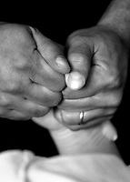 Mike Dahlan holds his wife's hand as she delivers their son Kai. Bringing life into the world. A young couple experiences the birth of their first child.