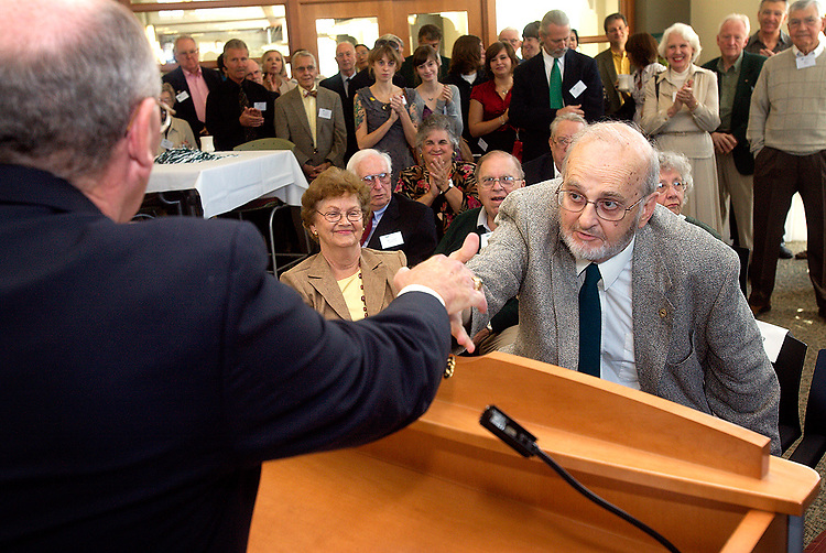 Photo by Kevin Riddell.Dr. Nicholas Dinos, right, shakes hands with Jim Edwards, Co-Chairman for fund raising for the Nicholas Dinos Professorship in Chemical Engineering, during a reception in the Maggie Davis Room of the Baker University Center on Saturday, September 29, 2007.