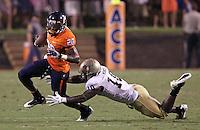 Sept. 3, 2011 - Charlottesville, Virginia - USA; Virginia Cavaliers wide receiver Tim Smith (20) runs past William & Mary Tribe linebacker Jabrel Mines (10) during an NCAA football game at Scott Stadium. Virginia won 40-3. (Credit Image: © Andrew Shurtleff
