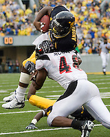 11 November 2006: West Virginia defensive back Quinton Andrews returns an interception.  The West Virginia Mountaineers defeated the Cincinnati Bearcats 42-24 on November 11, 2006 at Mountaineer Field, Morgantown, West Virginia..