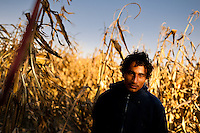 "A Salvadoran immigrant, hiding in the corn field, waits near the railroad track to climb up the cargo train passing through the train station in Huehuetoca, Mexico, 7 November 2014. Between 2010 and 2015, the US and Mexico have apprehended almost 1 million illegal immigrants from El Salvador, Honduras, and Guatemala. While the economic reasons remain the most frequent motivation for people from Central America to illegally immigrate to the US, thousands of Salvadorans, Guatemalans, and Hondurans, many of them minors, seek asylum in the US due to the thriving crime and gang-related violence in their region (known as the Northern Triangle). Taking an exhausting and risky journey, riding thousands of miles atop the cargo trains, facing a physical danger and extortion from the organized crime groups that control migrant routes, the ""undocumented"" still flee to the US, looking for their American dream."