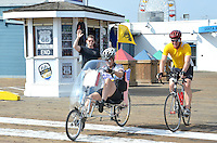 Retired U.S. Navy  Captain and current Litchfield City Administrator Andy Ritchie, 66, with his biking friend Mark Stieren, 52, depart from 66 to Cali at the Santa Monica Pier on. Sunday, May 6, 2012. Ritchie will be cycling from Santa Monica to Chicago on Route 66 to raise money for a Litchfield, Illinois Museum & Route 66 Welcome Center. He will be cycling approximately 2,400 miles total with a daily ride of about 80 miles. He is riding a Gold Rush recumbent bicycle built in America by Easy Racers. Ritchie plans on arriving on Sunday, June 3.