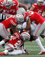 Northwestern Wildcats fullback Garrett Dickerson (9) gets tackled by Ohio State Buckeyes safety Malik Hooker (24), Ohio State Buckeyes cornerback Damon Webb (7) and Ohio State Buckeyes linebacker Chris Worley (35) during the second quarter of the NCAA football game between the Ohio State Buckeyes and the Northwestern Wildcats at Ohio Stadium on Saturday, October 29, 2016. (Columbus Dispatch photo by Jonathan Quilter)