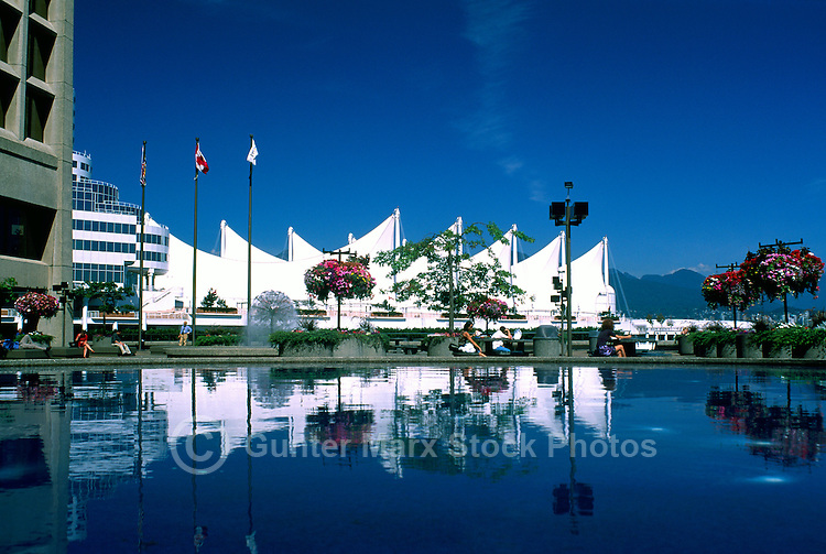 """Vancouver, BC, British Columbia, Canada - Sails of """"Canada Place"""" Trade and Convention Centre reflecting in Water Fountain at """"Granville Square"""", Summer"""