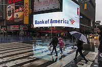The  Bank of America illuminated sign in Times Square is seen on a rainy Saturday, February 23, 2013. (© Richard B. Levine)