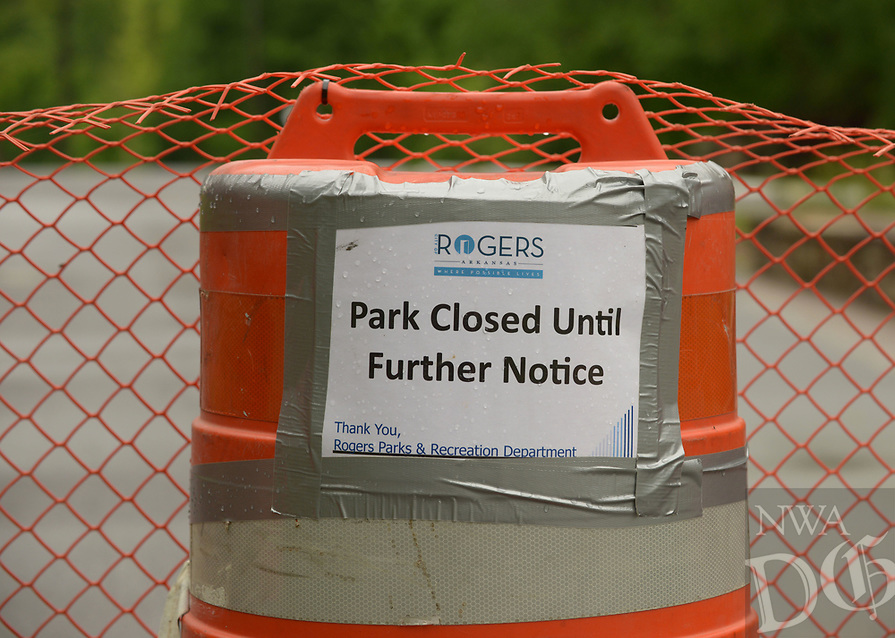 NWA Democrat-Gazette/BEN GOFF @NWABENGOFF<br /> A barrier closes off the parking lot Friday, May 12, 2017, at the South Pleasant Ridge Road access to Lake Atalanta Park in Rogers. Rogers Parks and Recreation plans to reopen some of Lake Atalanta park south of Walnut Street on Saturday.