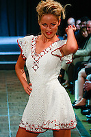 Ivana Surovcova, Slovakian Let's Dance finalist, walks runway in an outfit by American designer of Slovak origin Lucy Racek, during Slovak Fashion Night 2012 in New York City May 11, 2012.