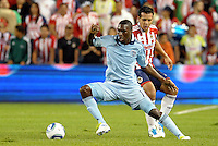 Sporting KC forward C.J Sapong (17)  gets by Mario de Luna (2) defender Chivas Guadalaljara... Sporting Kansas City and Chivas Guadalajara played to a 2-2 tie in an international friendly at LIVESTRONG Sporting Park, Kansas City, Kansas.