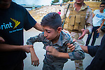 8/10/2015--Sulaimaniyah,Iraq-- A 11 years old boy is being transferred to the hospital after being shot by a plastic bullet.