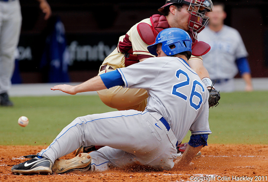 TALLAHASSEE, FL 4/24/11-FSU-DUKE BASE11 CH-The ball and Duke's Florida State's Duke's Dennis O'Grady get by Florida State catcher Parker Brunelle as O'Grady scores the sixth run in the second inning Sunday at Dick Howser Stadium in Tallahassee. The Seminoles beat the Blue Devils 13-9..COLIN HACKLEY PHOTO