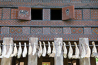 Rantepao, Tana Toraja, Sulawesi, Indonesia, October 2010. Buffalo jaws hang on the wall of raditional Tongkonan houses in the village of Balik.  When a Torajan dies in Toraja land, family members of the deceased are required to hold a series of funeral ceremonies that usually last for several days before the deceased is brought to a funeral site for burial. The Toraja people live a traditional life in the forested mountains of South Sulawesi.  Photo by Frits Meyst/Adventure4ever.com
