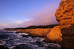Southern Oregon Coast Shore Acres State Park sunset light on cliffs and rock formations with fog mist near Coos Bay Oregon State USA.