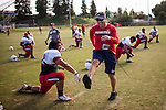 FRESNO, CA - AUGUST 11, 2014:   Fresno State defensive coordinator Nick Toth jokes with players during morning practice. CREDIT: Max Whittaker for The New York Times