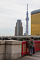 Sept. 30, 2011 - Tokyo, Japan -Two people look at the view of Tokyo Sky Tree from the Asakusa district in Tokyo. Travelers during Autumn Equinox Day, a national holiday in Japan. (Photo by Christopher Jue/AFLO)