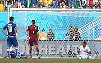 Luis Suarez of Uruguay (right) sits on the floor after an alleged incident with Giorgio Chiellini of Italy in which Chiellini claims Suarez bit him