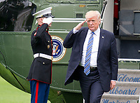 United States President Donald J. Trump salutes the Marine Guard as he disembarks from Marine One after traveling to Lynchburg, Virginia to make remarks at the Liberty University Commencement ceremony at the White House in Washington, DC on Saturday, May 13, 2017.<br /> Credit: Ron Sachs / Pool via CNP /MediaPunch