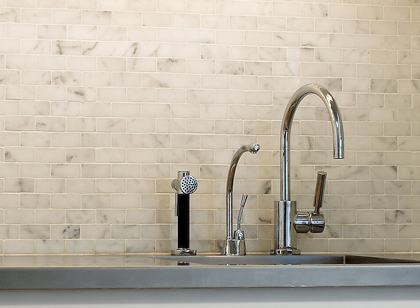 Runningbond 3x6cm backsplash shown in Calacatta Tia.