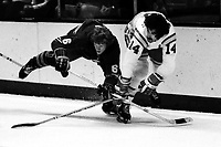 California Golden Seals vs Buffalo Sabres 1975<br />Sabres #6 Jim Schoenfeld and Seals #14 Jim Pappin against the boards. (1975 photo/Ron Riesterer)