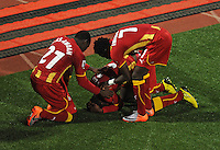 Asamoah Gyan of Ghana celebrates his goal with team-mates, Kwadwo Asamoah and Samuel Inkoom. Ghana defeated the USA 2-1 in overtime in the 2010 FIFA World Cup at Royal Bafokeng Stadium in Rustenburg, South Africa on June 26, 2010.