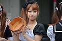 July 31st, 2011- Tokyo, Japan- Maid cosplayer sprinkling water: This summer, Japan is concerned for saving electricity due to the Fukushima nuclear plant disaster. Maids cos-players are doing water sprinkling to make the temperature cooler in Akihabara, Japan.(Photo by Yumeto Yamazaki/AFLO)