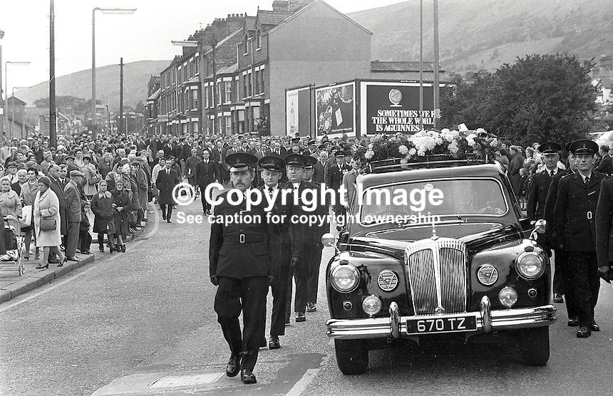 Thousands line the route of the funeral procession of Constable Cecil Cunningham who was shot by the IRA from a passing car while sitting in a stationary Royal Ulster Constabulary (RUC) car at the junction of Woodvale Road and Twaddell Avenue, Belfast. 420/71, 197110180420b..Copyright Image from Victor Patterson, 54 Dorchester Park, Belfast, UK, BT9 6RJ..Tel: +44 28 9066 1296.Mob: +44 7802 353836.Voicemail +44 20 8816 7153.Skype: victorpattersonbelfast.Email: victorpatterson@mac.com.Email: victorpatterson@ireland.com (back-up)..IMPORTANT: If you wish to use this image or any other of my images please go to www.victorpatterson.com and click on the Terms & Conditions. Then contact me by email or phone with the reference number(s) of the image(s) concerned.