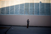 A man leaves after a Ron Paul rally at Jet Aviation in Nashua, New Hampshire, on Jan. 6, 2012.  Paul is seeking the 2012 GOP Republican presidential nomination.