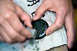 "Teruyoshi Kon sands down a product  made in the ""kara-nuri"" style  ofTsugaru lacquerware products in Hirosaki, Japan on 18 Jan. 2013. Photo: Robert Gilhooly.."