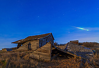 A bright bolide meteor breaking up as it enters the atmosphere and caught by chance at the beginning of a time-lapse sequence under the light of the Full Moon, April 25, 2013. Taken at the old farmstead near home, with the Canon 5D MkII and 24mm lens for 36 seconds at f/4 and ISO 800.