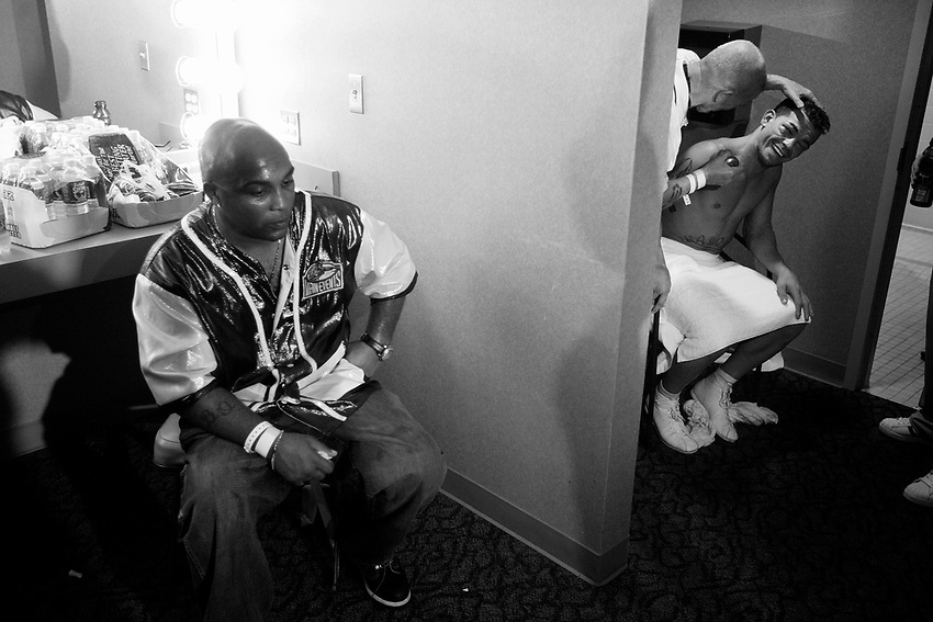 ARTURO GATTI (12/12) -- Buddy (left) sits with a blank expression on his face as cutman Joe Souza works Gatti's face in the dressing room after top-ranked contender Floyd Mayweather, Jr. defeats Gatti by TKO to win the WBC junior welterweight (140 pounds) title at Atlantic City's Boardwalk Hall.  ATLANTIC CITY, NJ  6/25/05