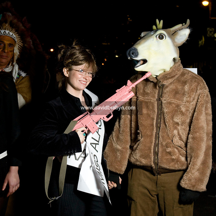 Parade-goers dressed as Republican vice-presidential candidate and Alaska governor Sarah Palin (L) and a moose pose for the photograph during New York's Village Halloween Parade on Sixth Avenue in New York City, USA, 31 October 2008.