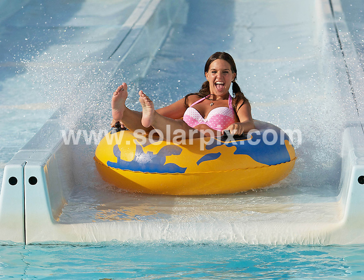 **ALL-ROUND EXCLUSIVE PICTURES FROM SOLARPIX.COM**.**NO PUBLICATION IN ZOO MAGAZINE UK**.**WORLDWIDE SYNDICATION RIGHTS**.Danielle Lloyd having fun at Aphrodite Waterpark in Paphos, Cyprus. The sexy serial WAG slipped into a frilly pink polka dot bikini and took to the water shoots on board a large yellow rubber ring. .JOB REF: 7938  AB1       .**MUST CREDIT SOLARPIX.COM OR DOUBLE FEE WILL BE CHARGED* *UNDER NO CIRCUMSTANCES IS THIS IMAGE TO BE REPRODUCED FOR ANY ONLINE EDITION WITHOUT PRIOR PERMISSION*