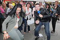13/10/2010. Crystal Swing Busking. Fan Melissa Redwood dances with Derek and Dervla Burke from Cork band Crystal Swing as they launch the busking contest outside the Gaiety Theatre, Dublin for the Mooney radio show on RTE. Picture James Horan/Collins Photos