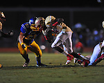 Lafayette High's Brandon Mack (4) tackled by Oxford High's Joel Forrester (61) at Bobby Holcomb Field in Oxford, Miss. on Thursday, August 30, 2012. Oxford High won 19-0.