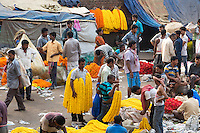The whole sale Flower Market near the Howrah Bridge at Calcutta (Kolkata) in West Bengal in India.