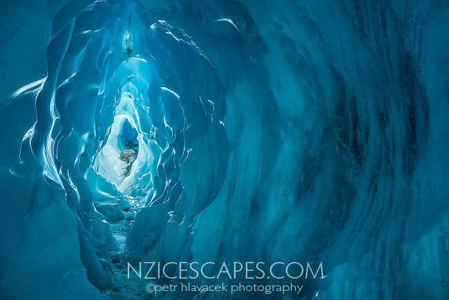 Amazing textures and shapes of blue ice tunnel, cave on Franz Josef Glacier, Westland National Park, West Coast, World Heritage Area, South Westland, New Zealand