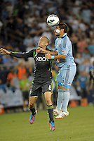 Paulo Nagamura (6) midfield Sporting KC wins the aerial battle with Osvaldo Alonso..Sporting Kansas City defeated Seattle Sounders on penalty kicks, after a 1-1 tied game to win the Lamar Hunt Open Cup at LIVESTRONG Sporting Park, Kansas City, Kansas..