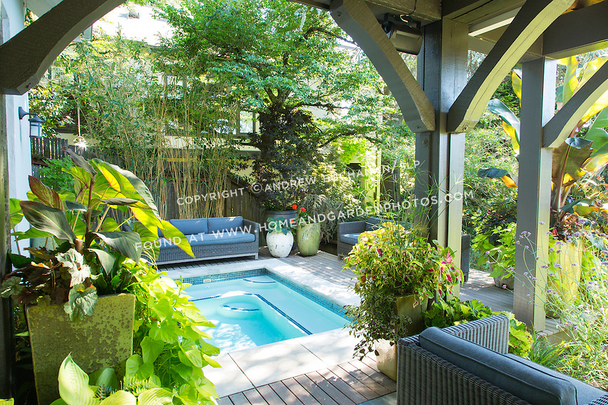 Lush container plantings surround the spa and seating area of the back deck. This image is available through an alternate architectural stock image agency, Collinstock located here: http://www.collinstock.com