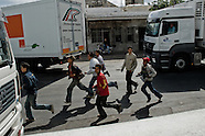 Haraga immigrants run to escape the Moroccan police near the entrance gate to the port of Tanger, Morocco, 17 June 2007. Every day tens of Moroccan young men try to cross ilegally the Strait of Gibraltar. ?Harraga? (immigrants in Arabic) come to Tanger from all over Morocco. They try their good luck and hidden between the wheels of a truck they attempt to board on a ferry and get to Spain, eventually further to Europe. Considering the thorough checks at the port only few of them make it. Therefore they spend months living on a beach, in huts along the walls of the port, begging for food and waiting for the right night so as their dream about Europe came true.