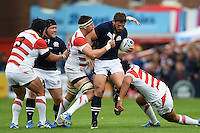 Ross Ford of Scotland takes on the Japan defence. Rugby World Cup Pool B match between Scotland and Japan on September 23, 2015 at Kingsholm Stadium in Gloucester, England. Photo by: Patrick Khachfe / Onside Images