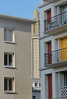 Detail of the facade of the apartment block at 50 Avenue Foch (right), designed by Auguste Perret, 1874-1954, who led the reconstruction of Le Havre in the 1950s, after the town was completely destroyed in WWII, Le Havre, Normandy, France. Avenue Foch is one of the widest avenues in Europe and forms part of the 'Monumental Triangle' at the heart of Le Havre's reconstruction plans. Seen between the buildings is the tower of the Eglise Saint-Joseph or St Joseph's Church, built 1951-58 as a memorial to the 5000 citizens of the town who died during the Second World War, designed by Auguste Perret and Raymond Audigier. The centre of Le Havre is listed as a UNESCO World Heritage Site. Picture by Manuel Cohen