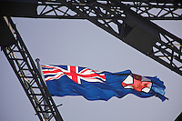 Close-up of the state flag of New South Wales (since 1876), one of the two flags flying atop the Sydney Harbour Bridge