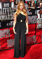 LOS ANGELES, CA, USA - APRIL 13: Actress Debby Ryan arrives at the 2014 MTV Movie Awards held at Nokia Theatre L.A. Live on April 13, 2014 in Los Angeles, California, United States. (Photo by Xavier Collin/Celebrity Monitor)