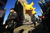 USA, NEW YORK, November 24, 2011.A Picachu balloon floats on Times Square while American celebrated the Macy's Thanksgiving day parade in New York, November 24,2011. VIEWpress / Eduardo Munoz Alvarez..The Macy's parade is considered by many to be the official start of the holiday season. Balloons, bands and dignitaries trooped through midtown Manhattan Thursday morning for the 85th annual Macy's Thanksgiving Day Parade. Media Reported.