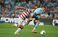 Wanderers Brendon Santalab (L) and Sydney FC Nikola Petkovic during their A-League match in Sydney, March 8, 2014. VIEWPRESS/Daniel Munoz EDITORIAL USE ONLY