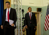 Chicago, Il - December 16, 2008 -- United States President-elect Barack Obama, center, enters the auditorium to announce his nomination of Chicago School Chief Arne Duncan, left, to be his Secretary of Education at a news conference at Dodge Renaissance Academy on Chicago's West Side on Tuesday, December 16, 2008..Credit: Ralf-Finn Hestoft - Pool via CNP