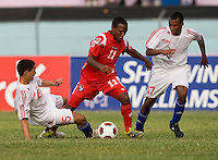 Osmani Capote (15) of Cuba tries to tackle the ball away from Aldair Paredes (11) of Panama during the group stage of the CONCACAF Men's Under 17 Championship at Jarrett Park in Montego Bay, Jamaica. Panama tied Cuba, 0-0.