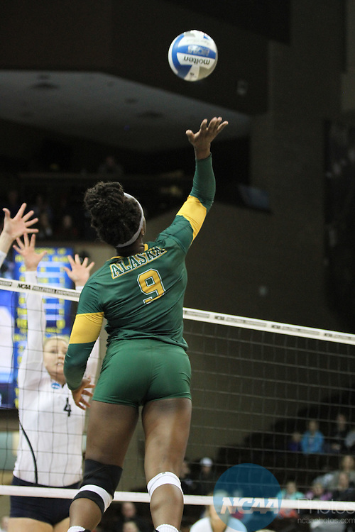 SIOUX FALLS, SD - DECEMBER 10:  Chrisalyn Johnson (9) of Alaska Anchorage tries for a kill against Concordia-St. Paul during the Division II Women's Volleyball Championship held at the Sanford Pentagon on December 10, 2016 in Sioux Falls, South Dakota. Concordia St. Paul defeated Alaska Anchorage 3-0  for the national title. (Photo by Jason Salzman/NCAA Photos via Getty Images)